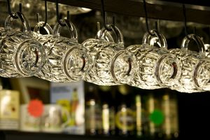 Beer glasses hanging on hooks in traditional pub