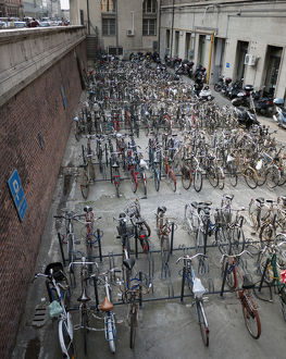 Bicycles in racks below street level in Bologna, Italy
