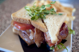 BLT, bacon, lettuce and tomato sandwich with cress garnish