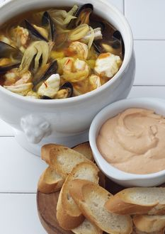 Bouillabaisse served in ceramic pot, with chilli mayonnaise dip and toasted white bread