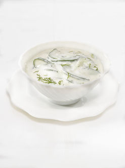 Bowl of cucumber and dill sauce made with mayonnaise and sour cream, close-up