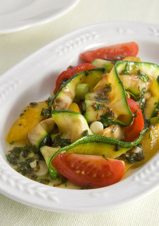 Bowl of grilled courgette salad, close-up