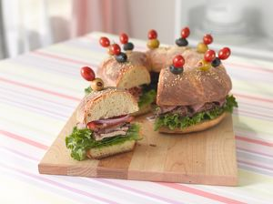 Bread ring stuffed with turkey, pastrami, tomatoes, onions and lettuce, and garnished