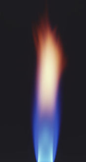 Bright blue and orange flame of bunsen burner, close up