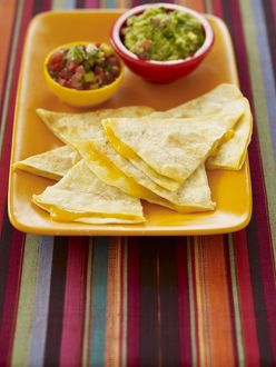 Cheese quesadillas with guacamole and salsa dips, close-up