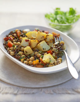 Chickpea, lentil and potato dish in bowl, close-up