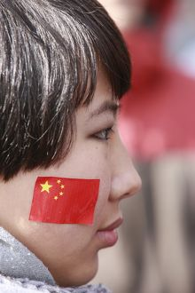Chinese woman watching the Olympic Torch Relay in Paris