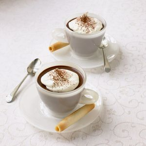 Chocolate cappuccinos on tablecloth
