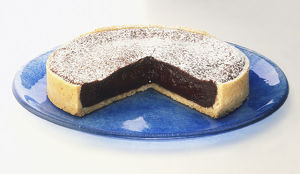 Chocolate tart with removed section, side view