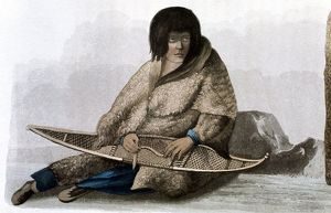 Copper Indian girl mending snow shoe.