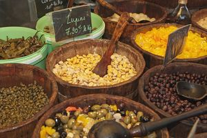 Corsica, Ajaccio, olives, capers, lupin beans for sales at market