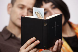 Couple reading a prayer book