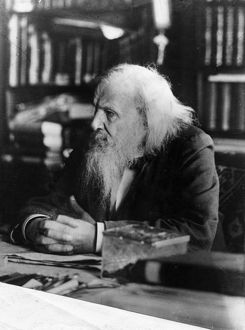 Dimitri ivanovich mendeleev, 1834 - 1907, the famous russian chemist in his study.