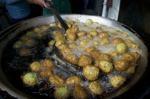 Egypt, Cairo, taamiya (falafel) being cooked in hot oil at food stall