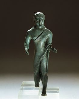 Etruscan bronze figurine of togaed man, from Villa Cassarini, Bologna, Italy, 500 B.C.