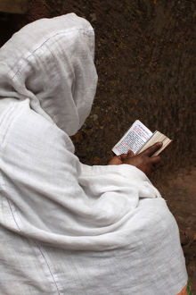 universal images group/editorial religion woman/faithful reading outside bieta ghiorghis saint