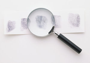 FINGERPRINTS AND A MAGNIFYING GLASS