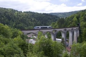 France, Franche-Comte, Ligne des Hirondelles, train crossing railway viaduct in the French Jura