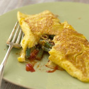 French bean, garlic and tomato omelette