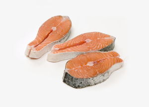 Three fresh salmon steaks