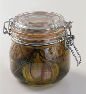 Garlic preserved in transparent airtight glass jar, close-up