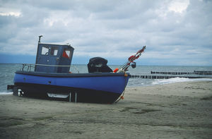 Germany, Usedom, a fishing boat on the beach