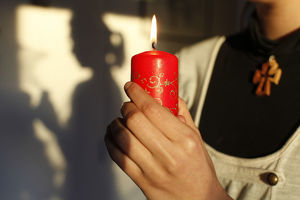 Girl holding a Christmas candle