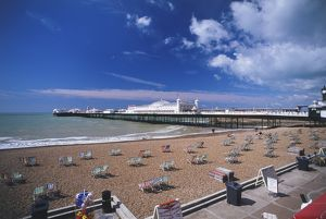 Great Britain, England, Brighton, view across sandy beach dotted with deckchairs