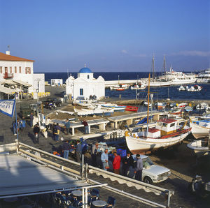 travel/greece mykonos harbour early morning local men