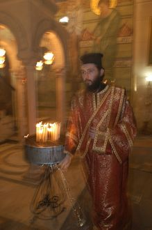 Greek orthodox priest in the Holy Sepulcher basilica in Jerusalem