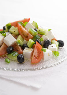 Greek salad with feta, tomatoes, and black olives, close-up