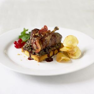 Grouse on toast served with redcurrant sauce