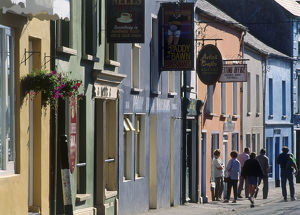 Ireland, County Kerry, Dingle, pedestrians in street lined with shops and cafes
