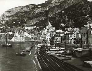 Italy, Naples, Amalfi harbour with boats on beach