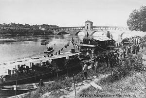 Italy, Pavia, Waterway transportation on Ticino River with Ponte Coperto (Covered