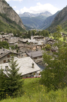 Italy, Valle d'Aosta, roof tops & valley view from Entreves, near Courmayeur