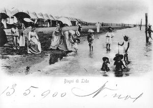 Italy, Venice, children playing in water, watched over by mothers and governesses at Lido Baths