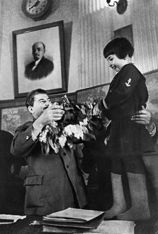 Joseph stalin receiving a bouquet of flowers from engelsina (gelya) markizova, the