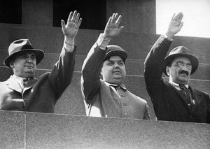 L, beria, g, malenkov, and a,mikoyan on the rostrum on lenin's tomb during a