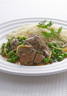 Lamb braised with green peas and couscous