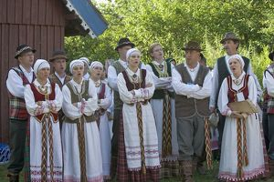Lithuania, Klaipeda County, Curonian Spit, Nida, people wearing traditional costumes
