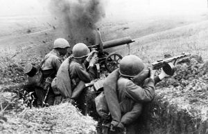 Machine-gunners firing at the germans during battle for a height in the northern