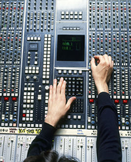 Man operating recording desk