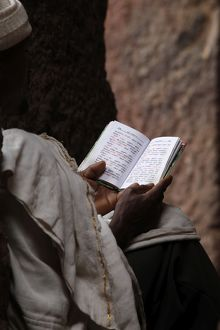 universal images group/editorial religion main/man reading scriptures outside bet medhane alem
