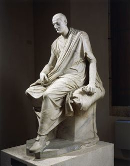 Marble statue of seated togaed man