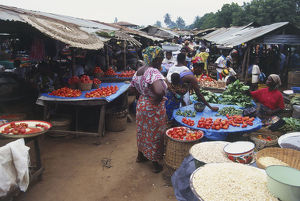 Market Stalls selling Vegetables, Dried Fish and Corn in Africa