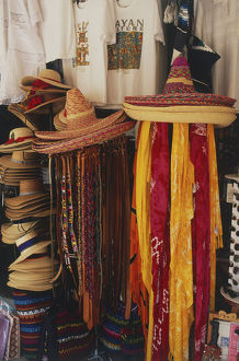 travel/mexico straw hats brightly coloured scarves street