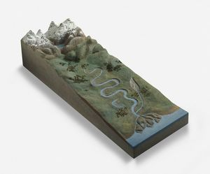 Model of winding river flowing from mountains to sea