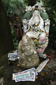 Money offering and statues in the garden of Buddhapadipa temple