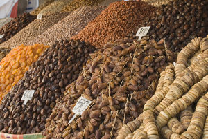 Morocco, Marrakech, Djemaa el Fna, dried fruits and nuts on display at market stall